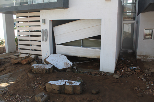 Flash flood inundates luxury estate… workmanship questioned after sudden downpour