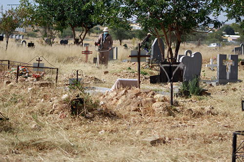Grieving families scramble for graves